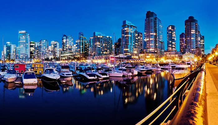 The lights of Downtown Vancouver bathe Coal Harbour Marina in shimmering colour.