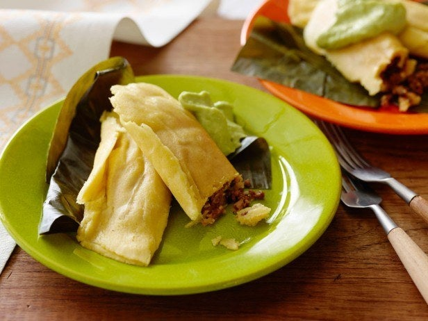 These soft cornmeal roll-ups are not unlike tamales, baked in banana leaves and filled with deliciously spiced meat.Country: Trinidad and TobagoTypical Filling: Beef, pork, and/or veggies.Recipe: Cornmeal & Meat Pastelles