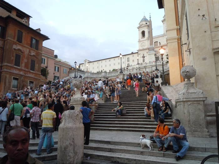 """Whether you're in Rome with a lover or traveling alone, the Spanish Steps are a beautiful place to enjoy Italy and relax. You can sit on a step with Italy's delicious gelato in your hand and listen to Bob Dylan's """"When I Paint My Masterpiece"""" while you enjoy the Roman scene around you."""