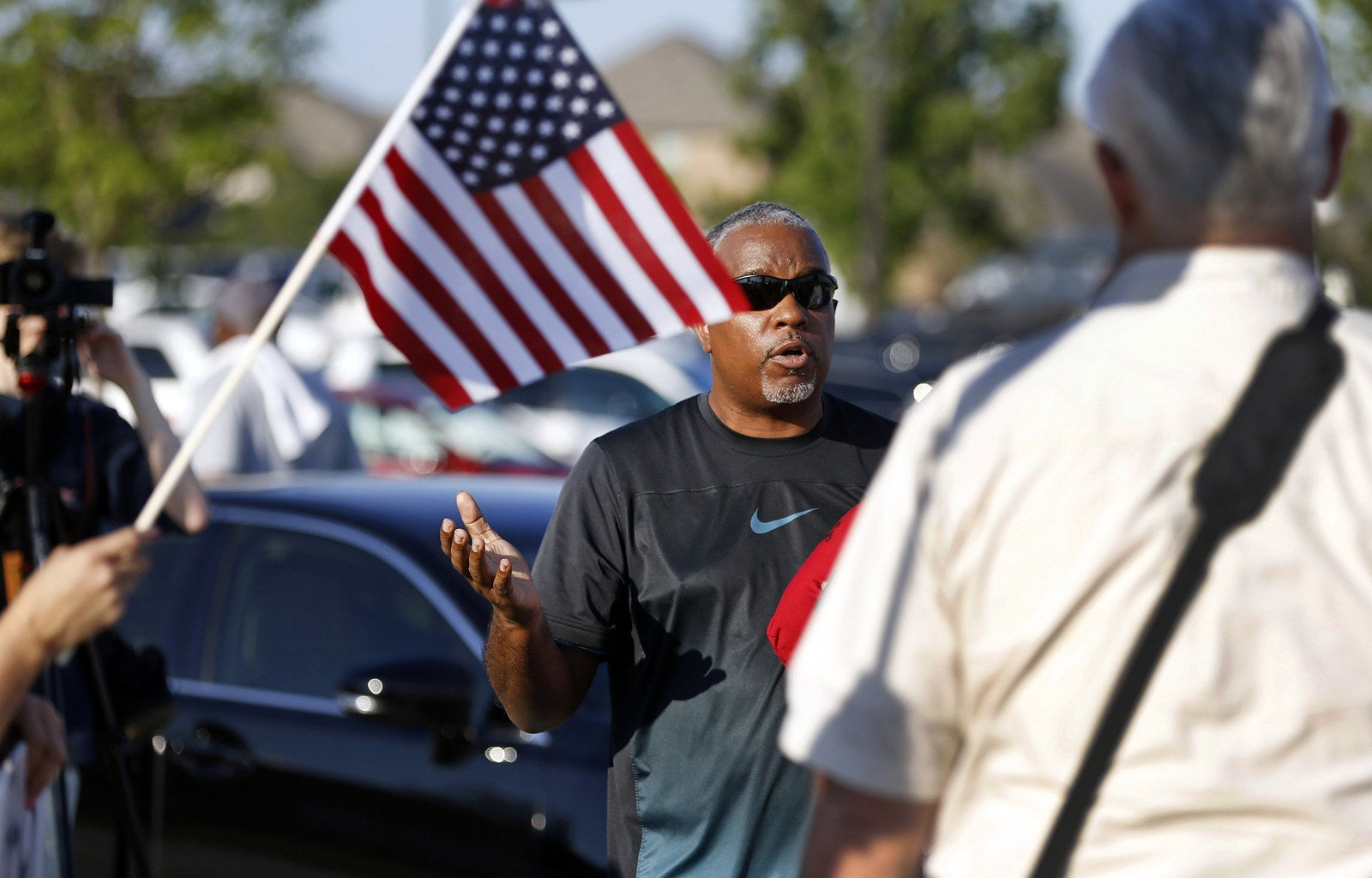An anti-police-brutality protester in McKinney on Monday.
