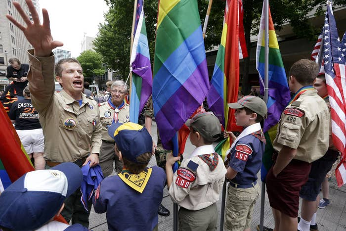 Scout leader Jesse Pacem (left) directs Cub Scouts and Boy Scouts as they prepare to lead marchers at the 41st annual Seattle Pride Parade Sunday, June 28.