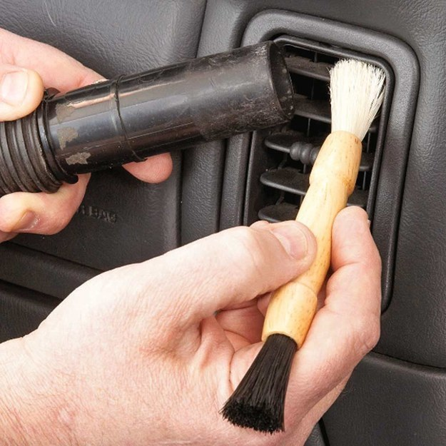 Vacuum up the dust as you brush it off, so it doesn't immediately settle somewhere else in the car.