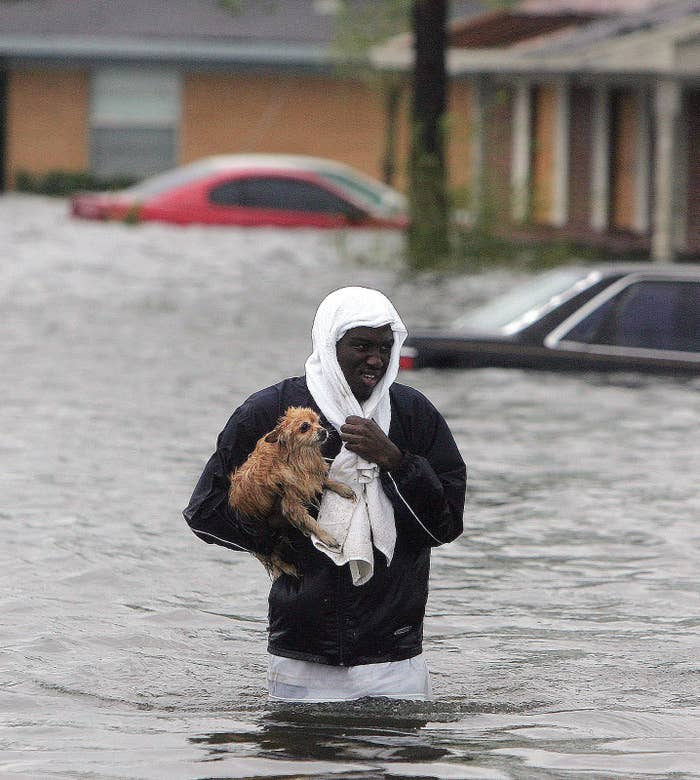 Jonathan Harvey wades through floodwaters on Aug. 29, 2005.