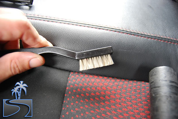 Use a fine-bristled brush (like a toothbrush) to get dirt and crumbs out from the seams of your seat cushions.