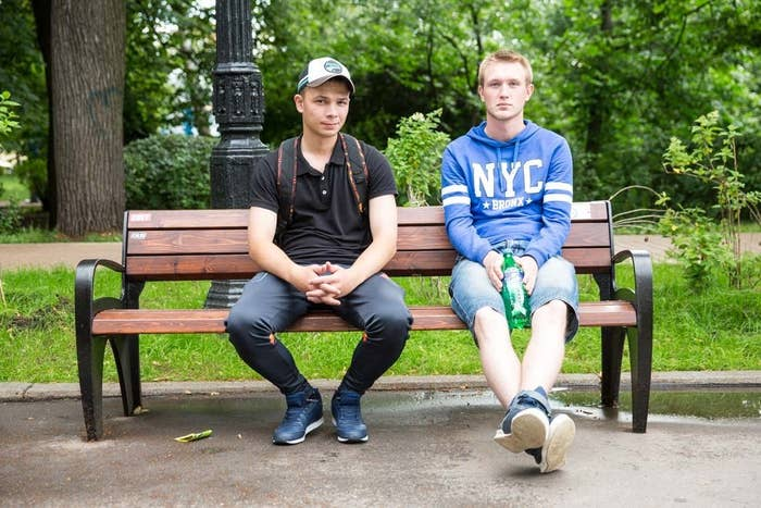Andrei, 19, wears a Bronx, NYC sweater, as he sits with a friend at a Moscow park. He had just finished his mandatory army service.