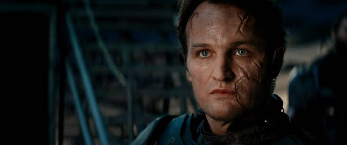 """John Connor (Jason Clarke) has some serious family baggage, given that his dad, Kyle Reese (Jai Courtney), is his younger bestie he eventually sends back to the past to his death in order to ensure his own salvation-of-humanity existence. The Terminator Genisys big twist that was, for some reason, included in all of the movie's advertising is that John is now the baddie, having been infected by Skynet to become a cyborg himself. But there's something extra villainous about the moment he tells Sarah Connor (Emilia Clarke) and Kyle that he thinks they're all """"exiles in time,"""" so he's not worried about what will happen to him if they're killed. Maybe he has a point, given that his future parents have already skipped ahead to 2017, two decades past when he was supposed to be born, and he still seems fine, if evil and robotic. But openly hand-waving away all continuity really undercuts the emotional stakes of the whole franchise — none of it counts apparently."""