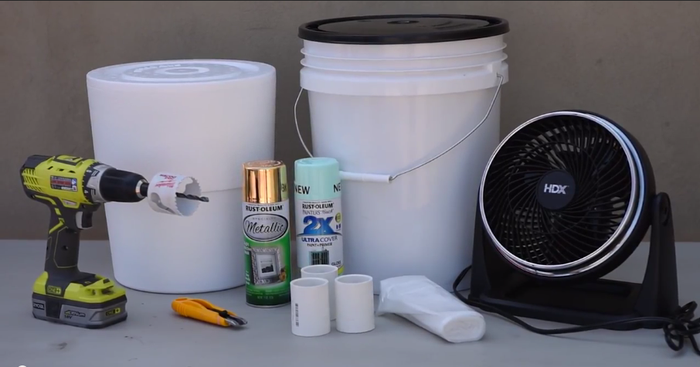 SUPPLIESTable fan - $16Bucket - $5Bucket lid - $3.50 1-1/2 in. PVC (cut into 3-inch segments) - $3.50Mint spray paint - $4Gold spray paint - $4Styrofoam bucket liner - $6 each 1-1/2 in hole saw for drill - $12Frozen gallon of waterTOOLSDrill Drop cloth Box cutter