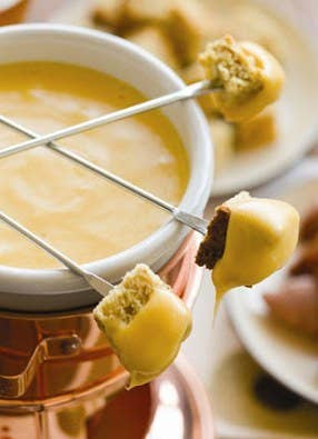 If you really want to wow your guests, fondue is a great way to surprise and delight. Having it as the centerpiece to each table is an awesome and delicious way to get people talking, as well as keep them full. You can include fruit, cheeses, breads, as well as cheese fondue or chocolate for each table.