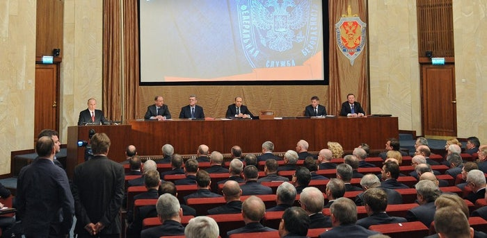 Russia's President Vladimir Putin (back L) speaks to members of the Russian security service, the FSB, in Moscow on April 7, 2014.