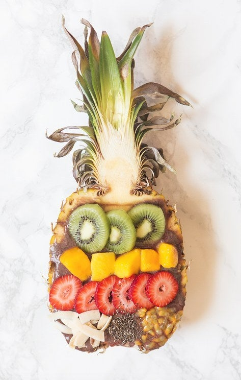 Served in a pineapple, topped to perfection. Recipe here.