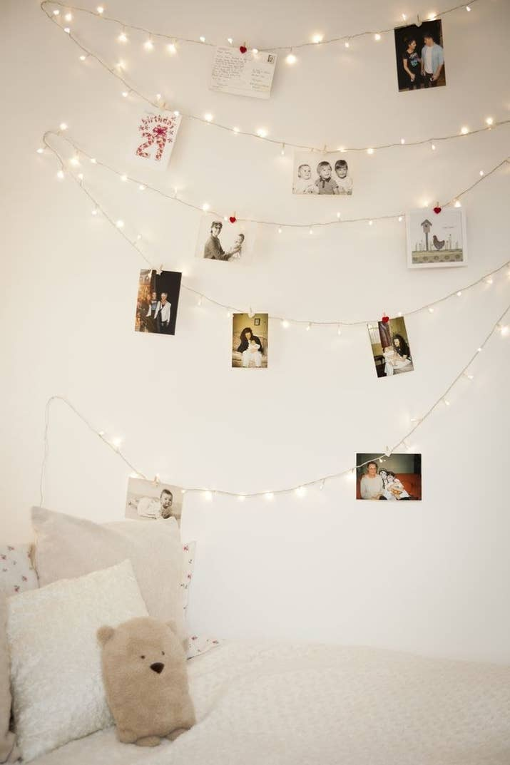 If you want to forgo frames, just clip photos onto a strand to display.