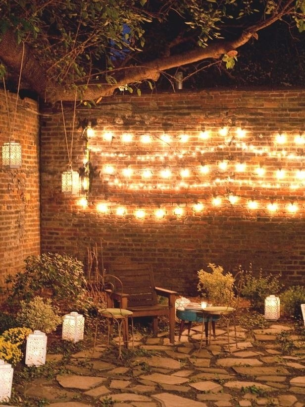 If you want to create quick outdoor mood lighting, hang string lights along a wall.