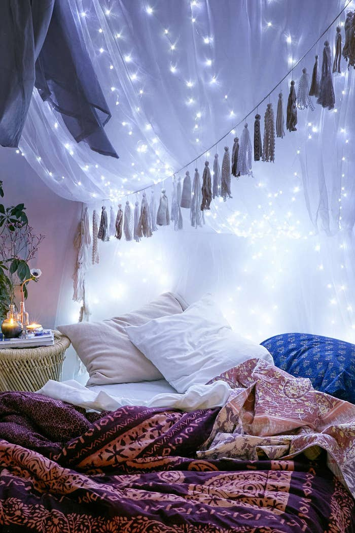 To Seriously Upgrade Your Sleeping Situation Drape Lights On Top Of Canopy