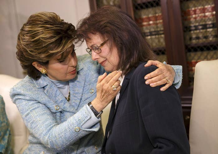 Attorney Gloria Allred comforts Linda Ridgeway Whitedeer, a former actress, as she speaks about her alleged assault by Bill Cosby during a news conference Wednesday.