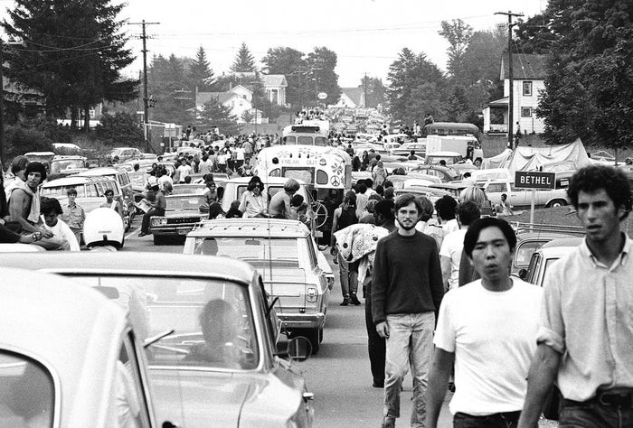 With thousands flocking to the small New York town, the roads became jam-packed and many abandoned their vehicles to set out on foot.