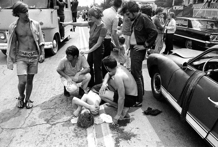 A young man with head injuries who was thrown from the trunk of a car on the road leading to Woodstock. Ambulances were unable to reach the scene because of the traffic.