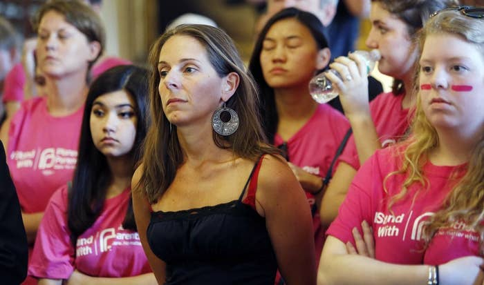 New Hampshire supporters of Planned Parenthood listen to hearing on the group's state funding.