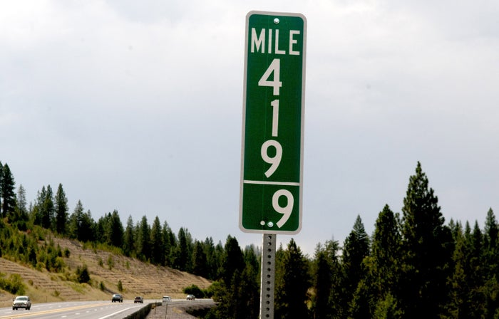 Vehicles pass a 419.9 milepost in Idaho on Aug. 11.