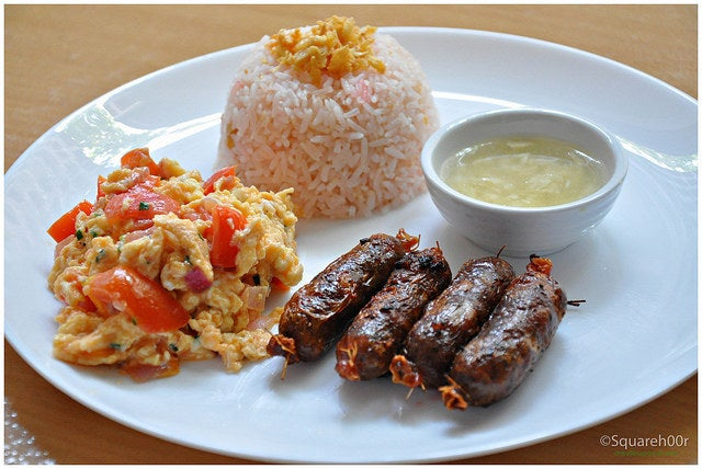 """What it is: Pinoy-style sausages (longganisa) with egg and fried rice.Why it's awesome: The taste of the sausages may vary from region to region, but one thing remains the same: """"Extra rice pa nga!"""" Recipe here and here."""