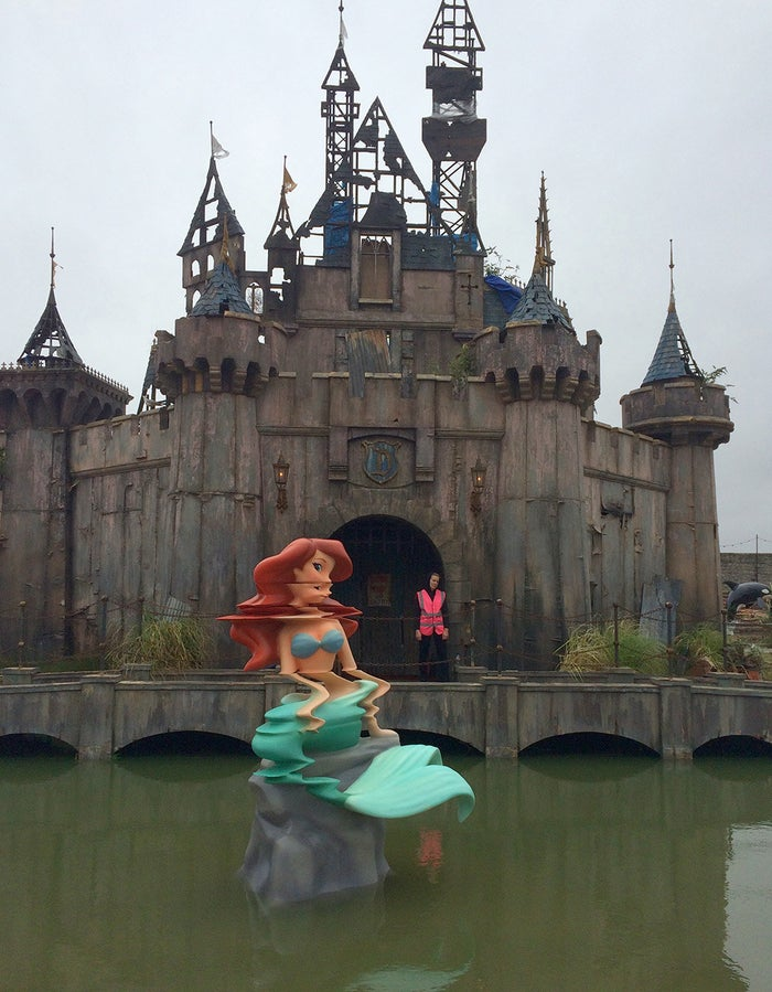 Dismaland is a five-week show housed inside and around a derelict Tropicana building in Weston-super-Mare, a seaside town in Somerset, England.