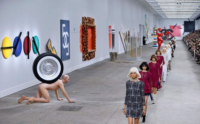 Karl Lagerfeld presented his art-inspired collection in front of 75 unique pieces he made for the show, some already with red stickers beside the name as if they were sold.