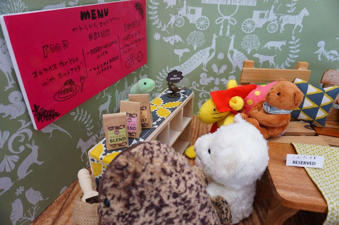 Anything that's not stuffed with fluff (ie. human beings) is not allowed. The cafe asks that you make a reservation for your toy, and on that day, you mail it in.