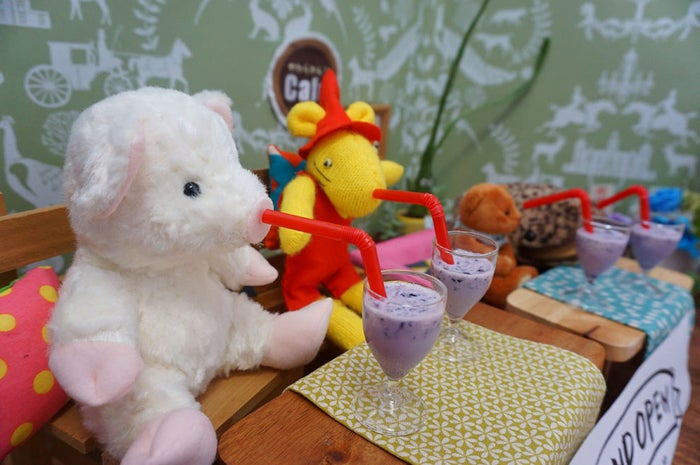 The toys are sat on their specially reserved seats and given welcome smoothies.