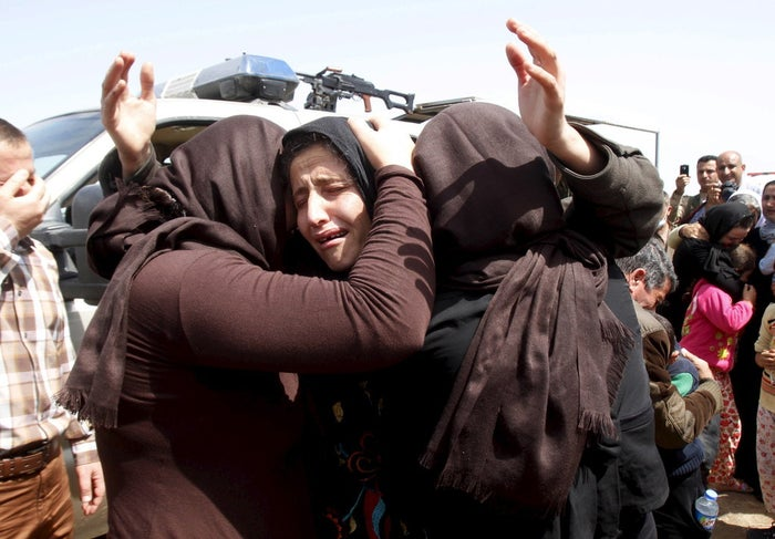 Members of the minority Yazidi sect hug each other on the outskirts of Kirkuk in April.