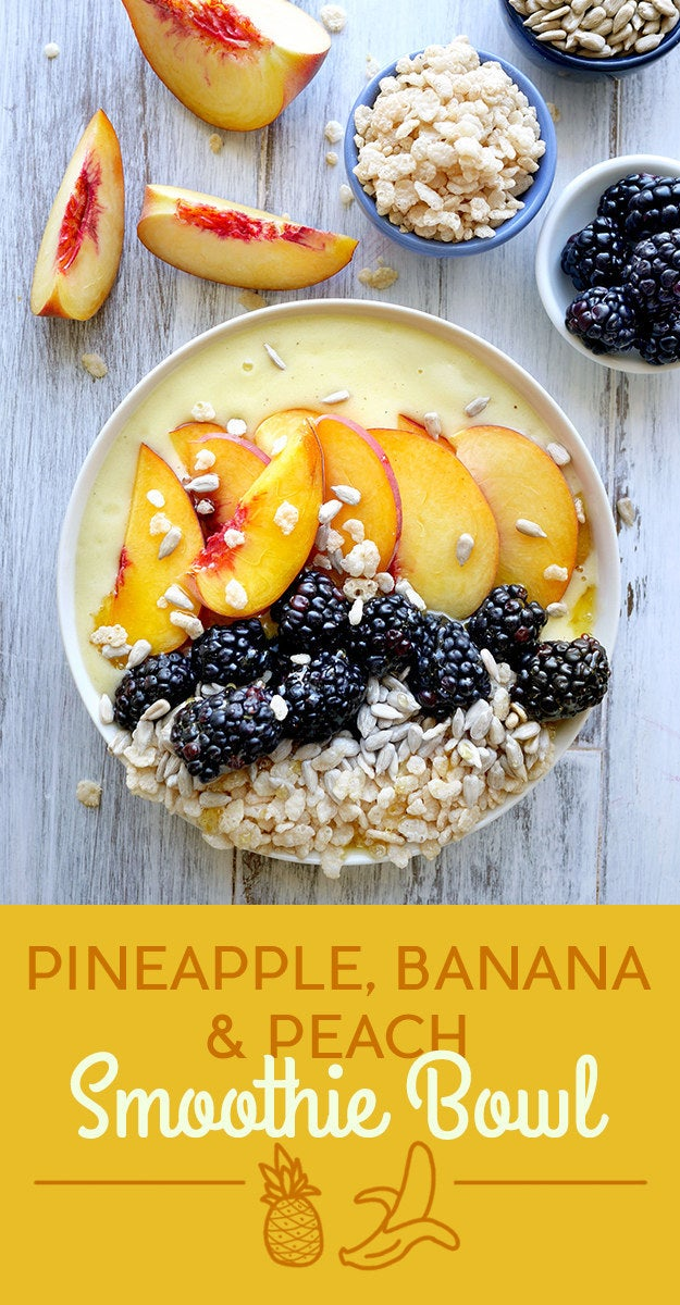 To make the smoothie, blend pineapple, banana, coconut water, and honey. The toppings are peach, blackberries, sunflower seeds, and puffed rice cereal. Get the recipe at the bottom of the post.