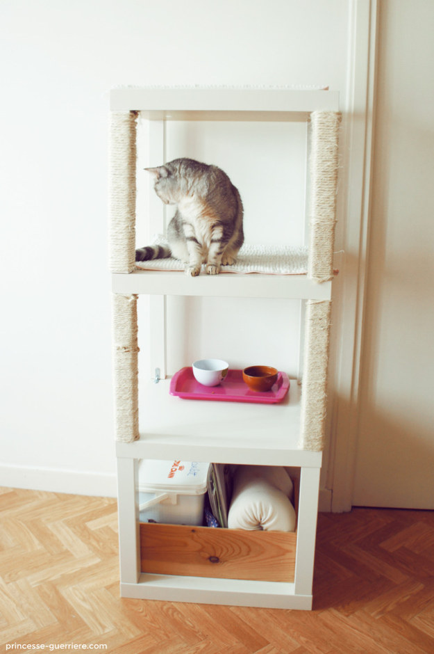 And stack those end tables to create shelves for your cat to lounge on, and for pet supply storage.