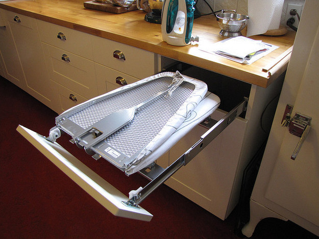 Put a fold-out ironing board in a spare drawer.