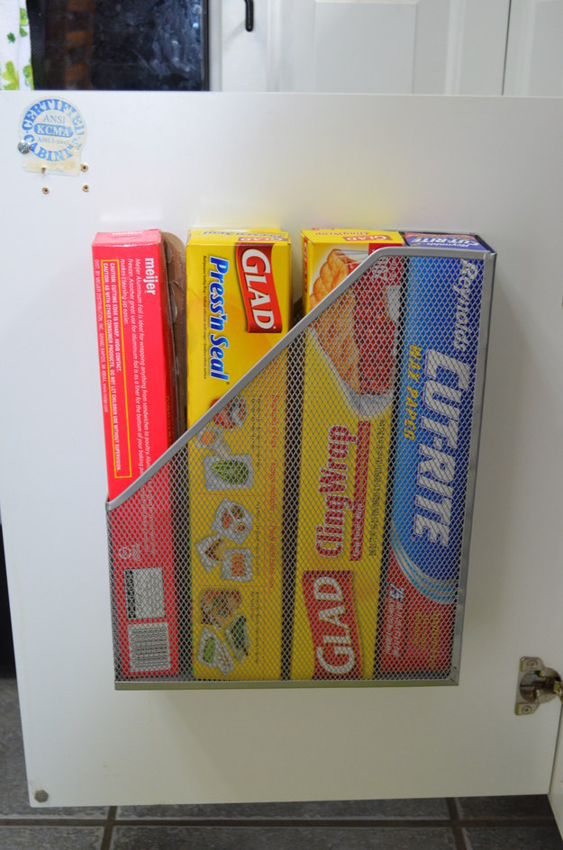 Store your foil and plastic wrap in a mounted magazine rack.