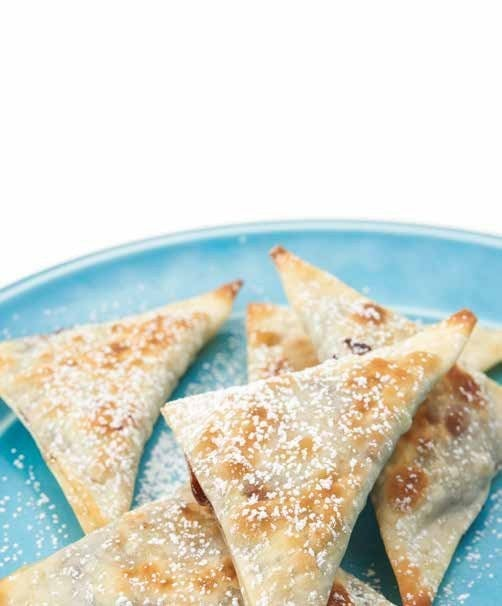 Nutella and banana cuddled together into little crispy pockets of nom? It's the sweetest love story there ever was. 1⁄2 cup Nutella16 wonton skins1 banana, sliced into 15 thin roundsOlive oil or nonstick cooking sprayConfectioner's sugar (optional)Preheat the oven to 375°F. Place 1/2 tablespoon of Nutella into the center of each wonton skin. Put a banana slice on the Nutella. Dip your finger in some water, run it along the edge of the skin, and fold the skin in half, pressing to seal. Arrange the prepared ravioli on a greased baking sheet. Brush the ravioli with olive oil. Bake until the skins are crispy and golden brown, 8 to 10 minutes. Let cool slightly, then serve. If desired, dust the ravioli with confectioner's sugar just before serving.
