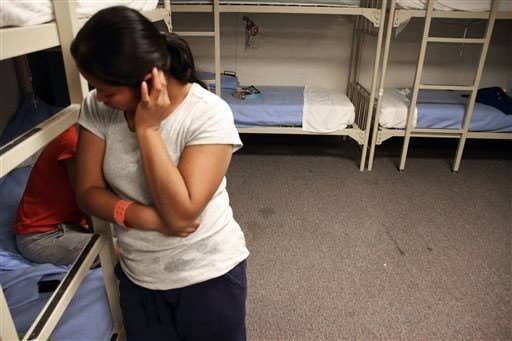 An unidentified Guatemalan woman in a dorm at the Artesia Family Residential Center in Artesia, N.M.