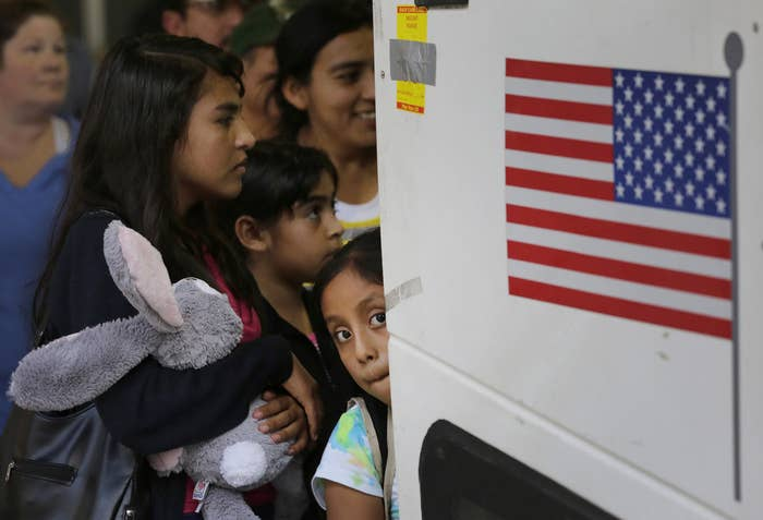 Immigrants from El Salvador and Guatemala board a bus after being released from a family detention center in San Antonio, Texas.