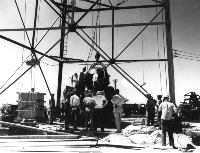 "An atomic bombshell is hoisted to the top of a tower at Alamogordo, New Mexico. At the White Sands Proving Ground, code name ""Trinity"" would become the world's first-ever detonation of a nuclear weapon."