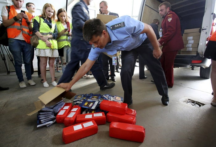 Packs of sliced meat and cheese are placed on the ground as part of a display of illegally imported food falling under restrictions in the territory of Pulkovo airport in St. Petersburg, Russia on August 6, 2015.