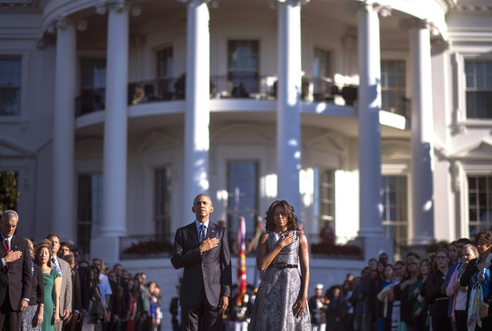 President Barack Obama and First Lady Michelle Obama, stand as Taps is played on the 14th anniversary of the September 11 terrorist attacks on the United States. Today marks the 14th anniversary of the attacks where nearly 3,000 people were killed in New York, Washington D.C. and Pennsylvania.
