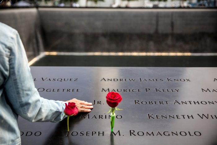 People take a moment of silence to remember loved ones during an anniversary ceremony commemorating the terrorist attacks of September 11, 2001 in New York City.
