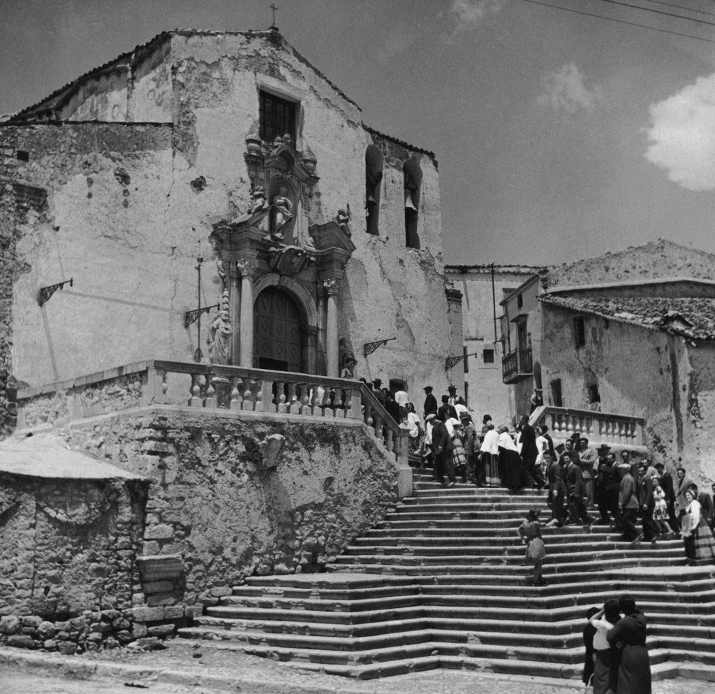 Wedding guests on the steps of the church in Piana dei Greci, Sicily. Circa 1950.