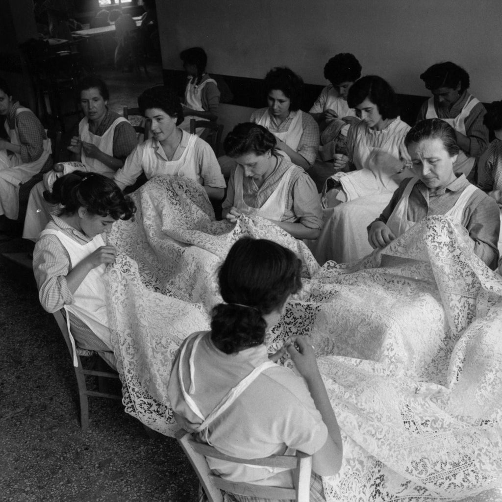 Girls on the Venetian island of Burano learning the art of making lace. Circa 1954.