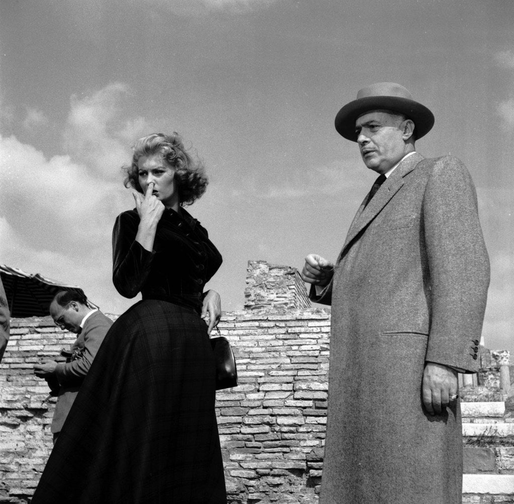 Sophia Loren on location at Ostia Antica for the filming of 'La Fortuna di Essere Donna' with the French actor Charles Boyer.
