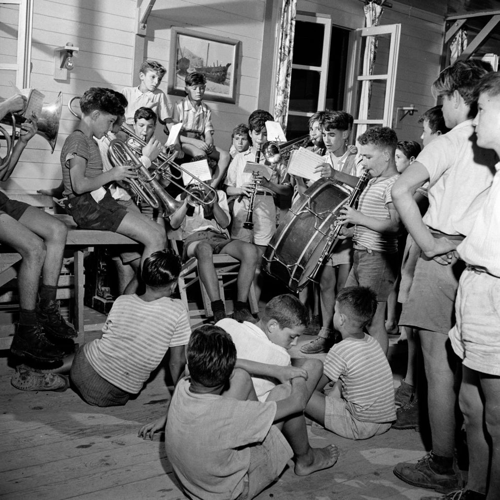 A group of boys playing in a village band. Circa 1950.
