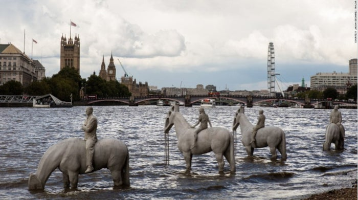 The new temporary addition to the banks of the Thames near Vauxhall is called 'Rising Tide' and features the four horsemen of the climate apocalypse. The sculpture gets completely submerged twice a day at high tide and artist Jason deCaires Taylor says that the horses have petrol pumps for heads to represent our dependency on fossil fuels. And the rising tide bit, well that's obvious isn't it.