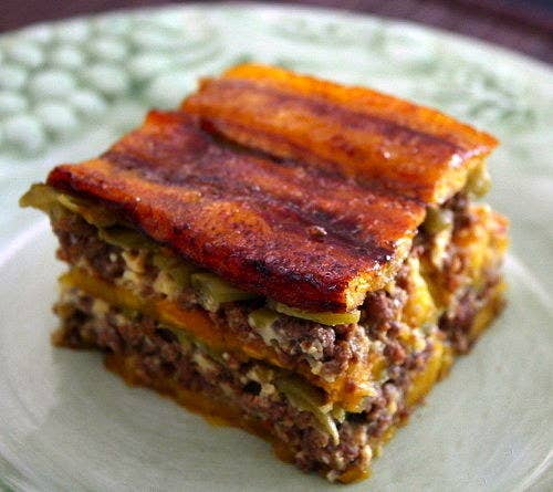 Also called pastelón in Puerto Rico, this recipe will make you smile with pure happiness. Making it is very similar to conventional lasagna, but with flattened plantains instead of pasta. Here's how to make one of the many versions of this delight.