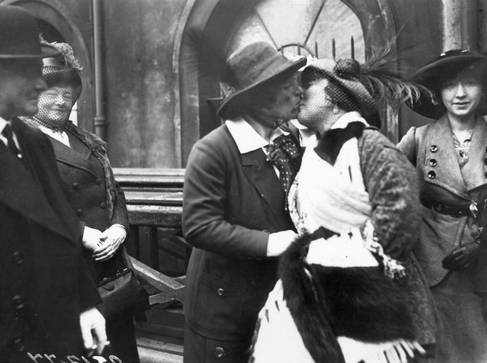 English music hall entertainer Marie Lloyd embraces Claire Roumaine at Paddington Station on Roumaine's return from Australia. April 1913