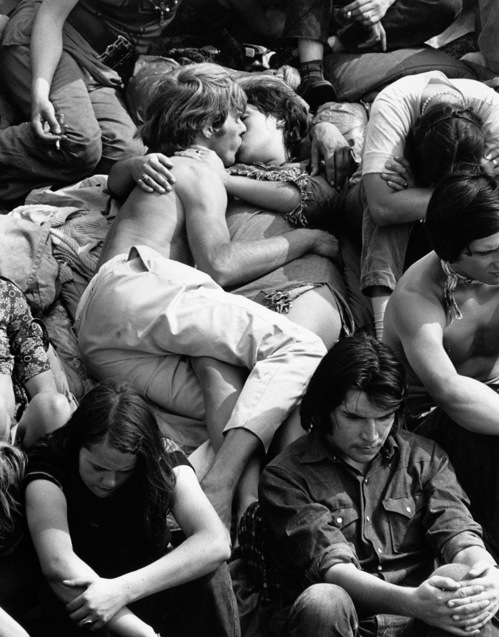A couple kissing in the crowd at the Isle of Wight Pop Festival. 1970.