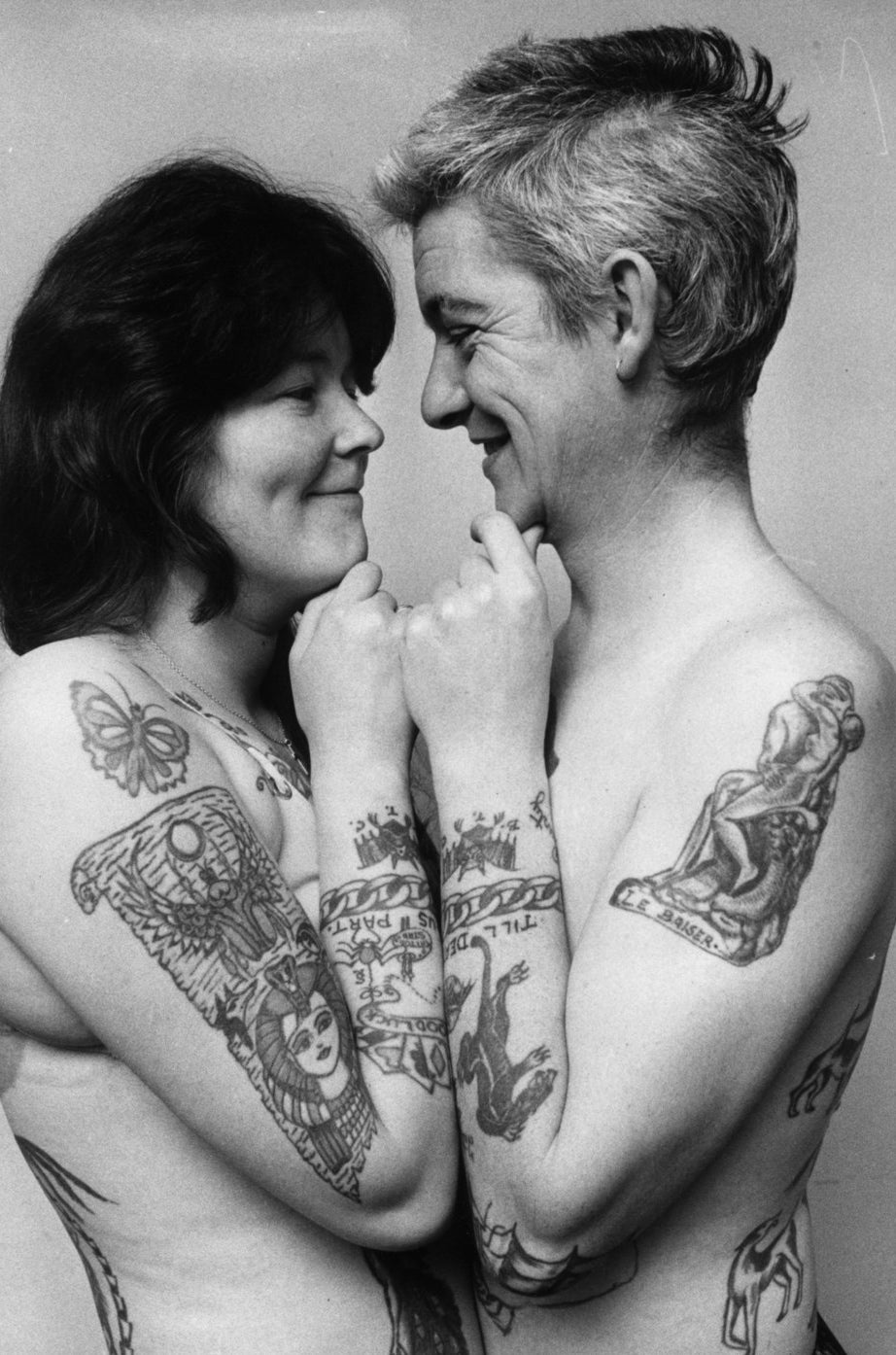 Ivor and Marianne Collier, display their mutual adoration and taste for tattooes. 1972.