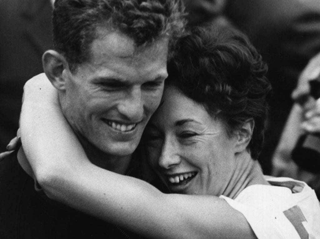 Ann Packer of Great Britain, winner of the 800 metres final at the 1964 Tokyo Olympics, gives her boyfriend Robbie Brightwell, captain of the British team, a big hug. She also won silver in the 400 metres.