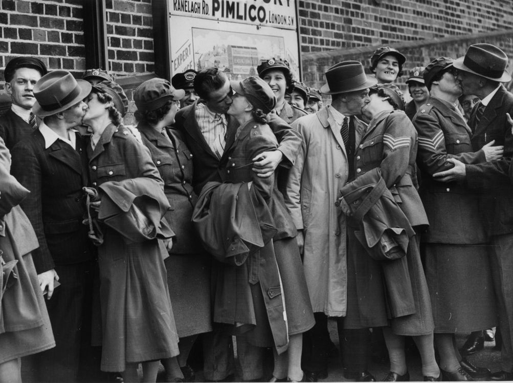 Members of the 3rd Women's Territorial Service, leaving Croydon station for their fortnight's training under canvas, kiss their husbands and boyfriends goodbye. August 1939